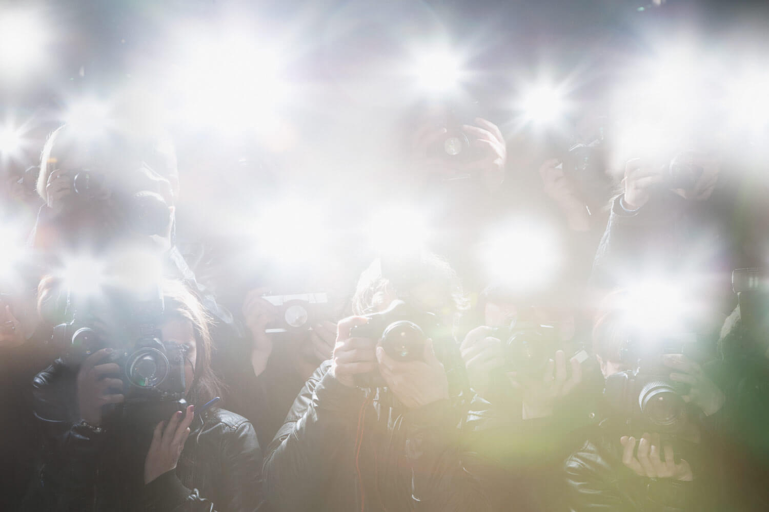 Flashing lights from paparazzi cameras taking pictures of celebrities after cosmetic dentistry